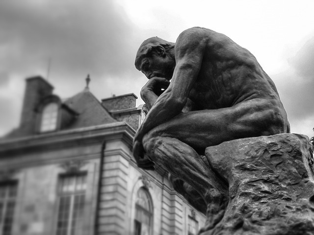 A mnemonic of the Mnemoriam as Rodin's The Thinker