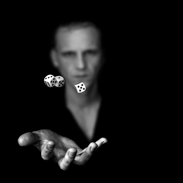 Gambler throwing dice